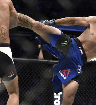 (R-L) Donald Cerrone kicks Robbie Lawler during the UFC 214 event inside the Honda Center on July 29, 2017 in Anaheim, California