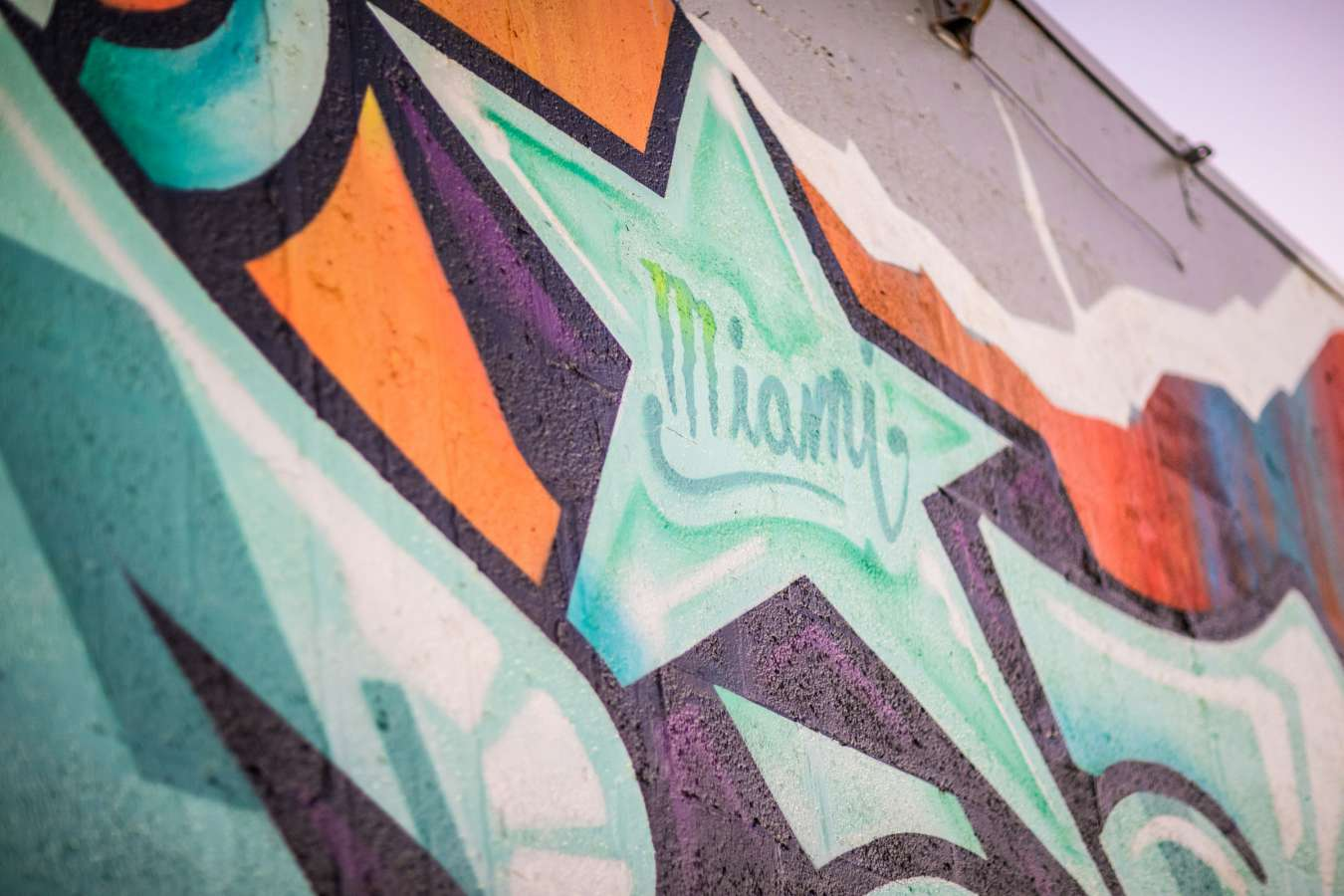 images of Risk painting his wall at Art Basel Miami