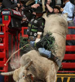 JB Mauney attempts to ride Dakota Rodeo/Chad Berger/Jerry Brown's Boot Jack during the second round of the Built Ford Tough series PBR World Finals.