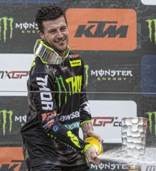 Clement Desalle celebrating on the podium of 2018 MXGP Trentino