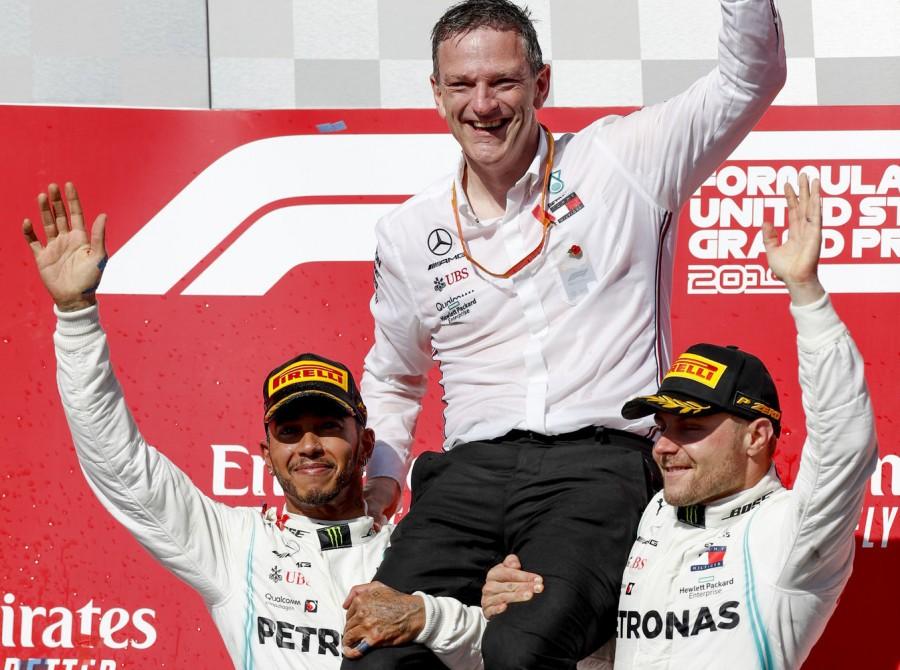 Lewis Hamilton and Valtteri Bottas celebrate with Mercedes-AMG Petronas Motorsport Team Technical Director James Allison